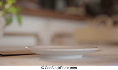 A man puts a cup of coffee on the table