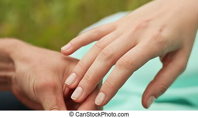 A man puts a ring on the finger of a woman