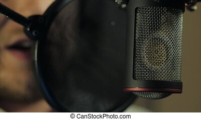 A man reads rap in a recording studio near microphone. 4K