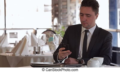 A man receives a call at lunchtime - Business lunch in a...