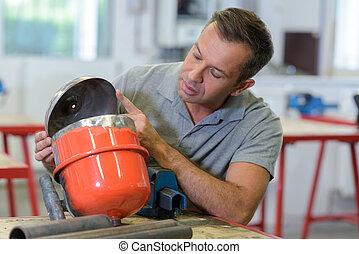 a man repairing water pump
