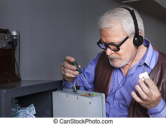 A man repairs the safe