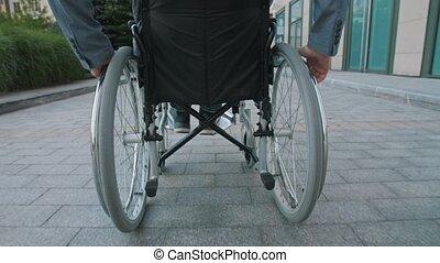 A man rides in a wheelchair