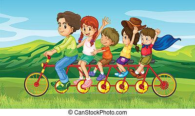 A man riding a bike with four kids