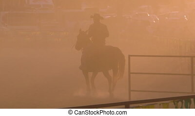 A man riding a horse on a ranch - A hand held close up shot...