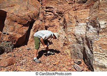 man rockhounding
