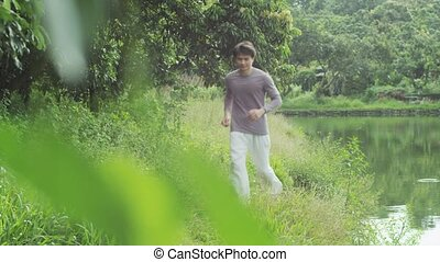a man running at waterside