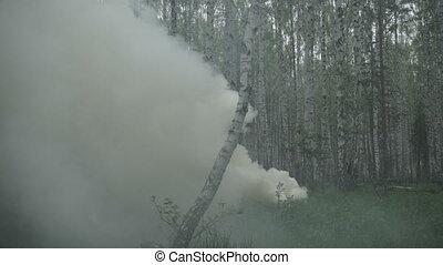 A man runs out of smoke