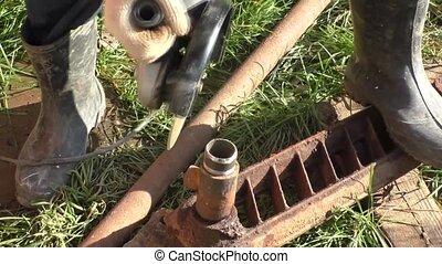 A man sharpens pipe