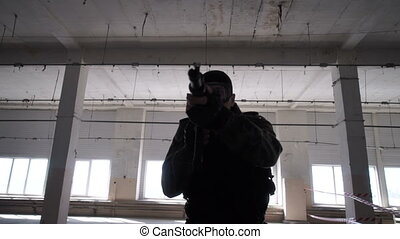 A man shoots a pistol - Playing airsoft in the building