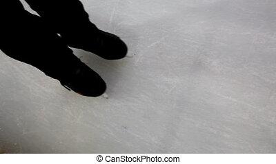 A man skates on ice