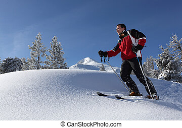 a man skiing in the snowy country