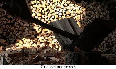 A man split oak log long old ax - A man professionally split...
