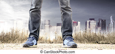 man standing in the suburbs