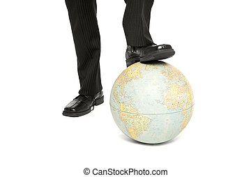 A man steps on a globe