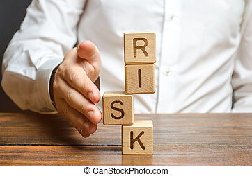 A man straightens a segment in an unstable tower of cubes labeled Risk. Risk management, cost assessment, and business and investment safety. Strengthen business resilience and flexibility.