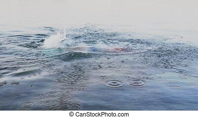 A man swims in the sea doing sports