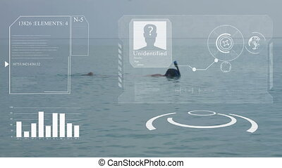 A man swims on a blue sea with a snorkel and mask. Hud. The...