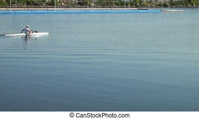 A man swims on a kayak