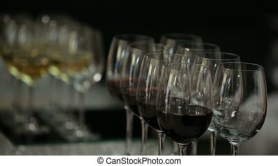 a man takes glass of wine on an evening-party