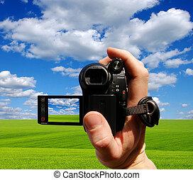 video camera - a man takes off field a video camera
