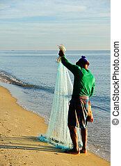 A man throw fishing net, Thailand