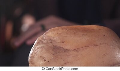 a man touches his jade stone