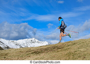 A man trains for ultra run trail in the mountains
