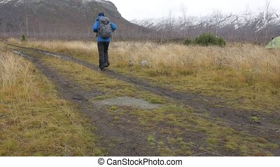 A man travels with a backpack. Hiking adventures. He leads an active and healthy life