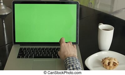 A Man Types on a Laptop on His Desk.