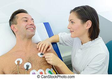 a man undergoing cardiovascular examination