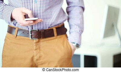 A man using a smartphone in office