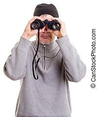 A man using binoculars