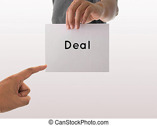 a man using hand holding the white paper with text deal