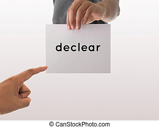 a man using hand holding the white paper with text declear