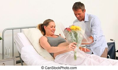 A man visiting his pregnant wife