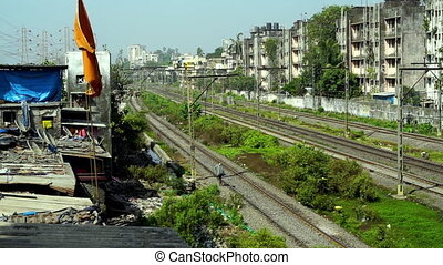 A man walking on train tracks - A wide shot showing a man...