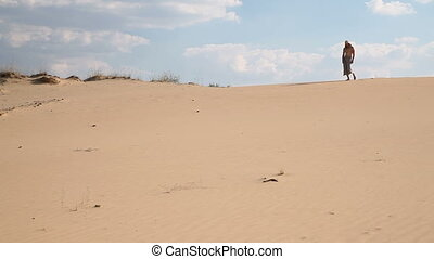 A man walks through the desert