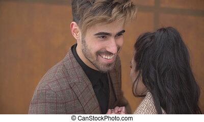 a man warms his girlfriend's hands