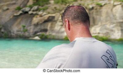 A man wearing a snorkeling mask