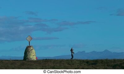 A man wears a son on his shoulders and walks along the plain. Andreev.