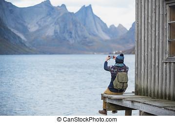 Traveler make a photo by phone.
