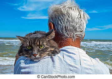 a man with a cat on his shoulder