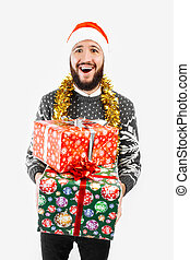 A man with a Christmas gift in his hands, in the Studio on a white background