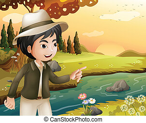 A man with a hat at the riverbank