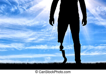 A man with a prosthetic leg standing closeup. The concept of...