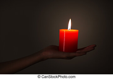 A man with a red candle