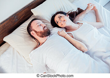 a man with a woman in the morning woke up in a bedroom dream...