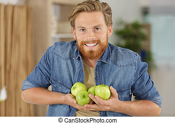 a man with apple fruit