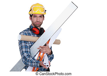 A man with his arms full of tools.